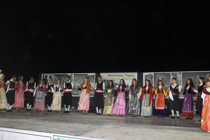 dancers in traditional greek costumes