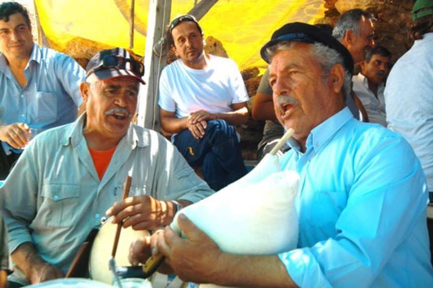 old men singing and playing music