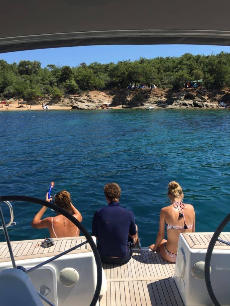 tourists at Salonikios Beach ready to dive