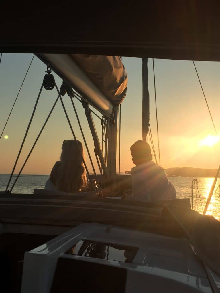Romantic couple and sunset at Aeolus Yacht