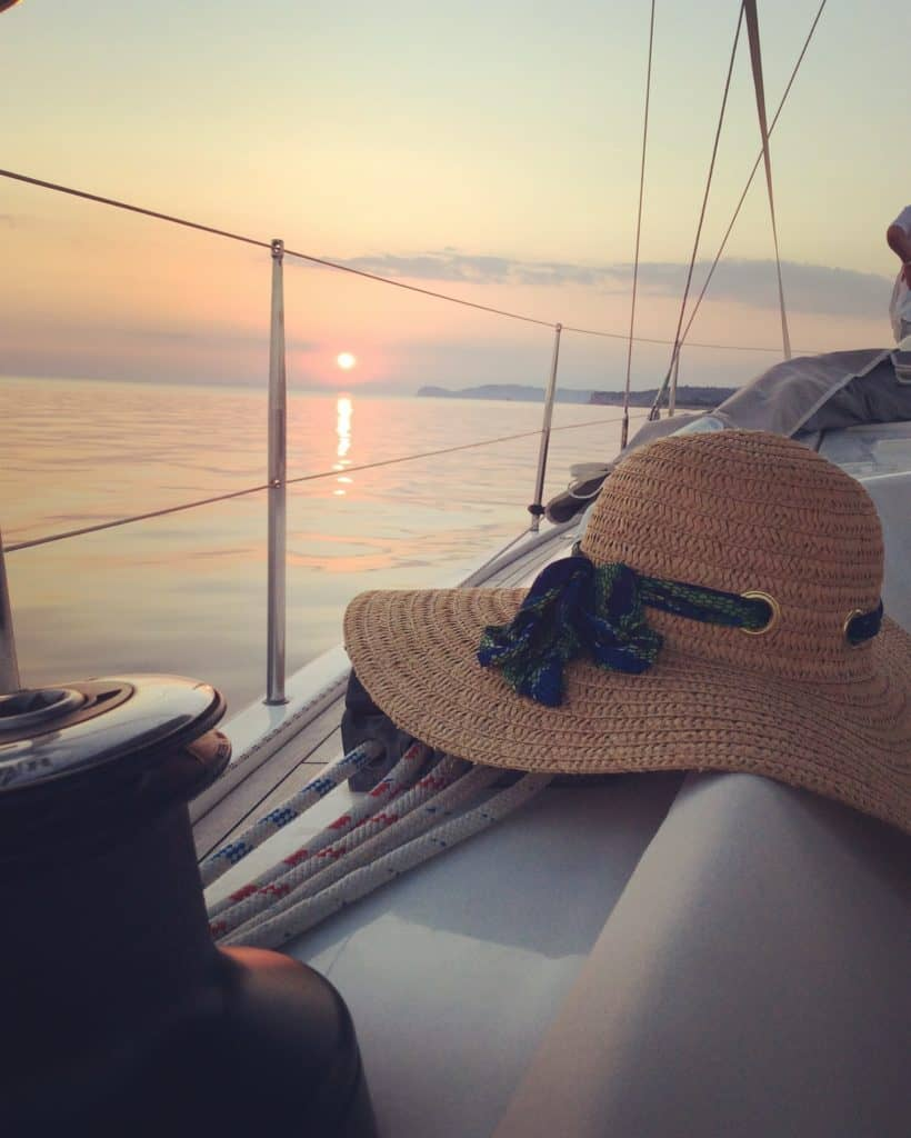 sunset at Aeolus yacht and hat