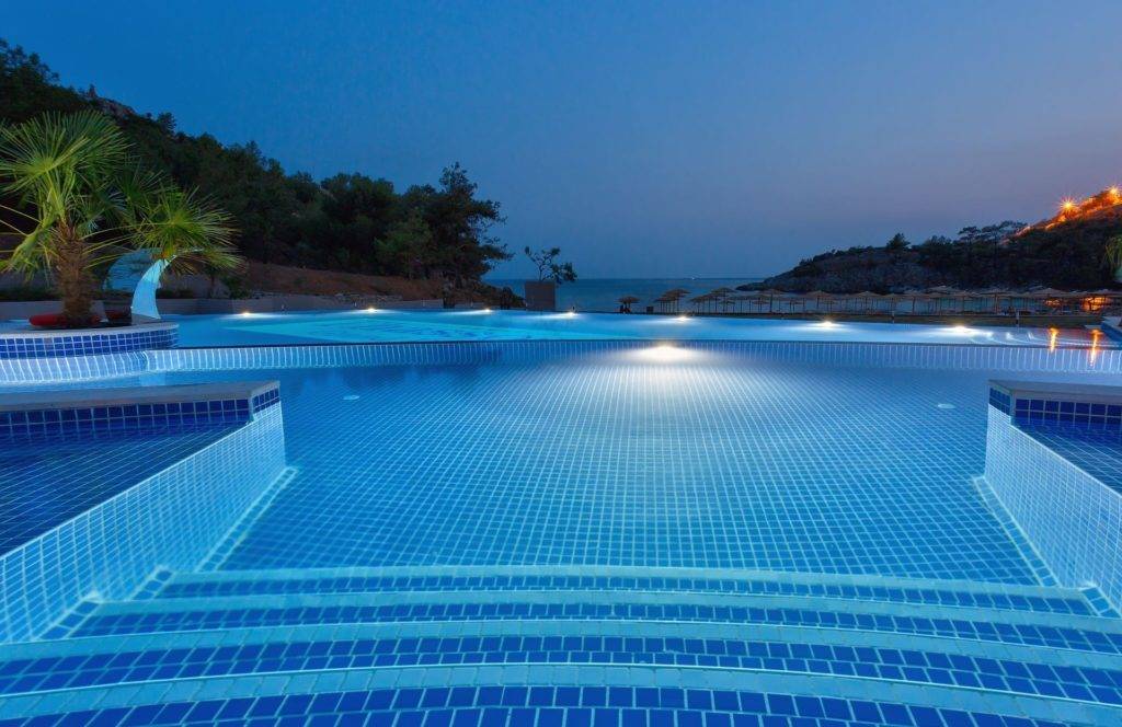 thassos grand resort pool by night