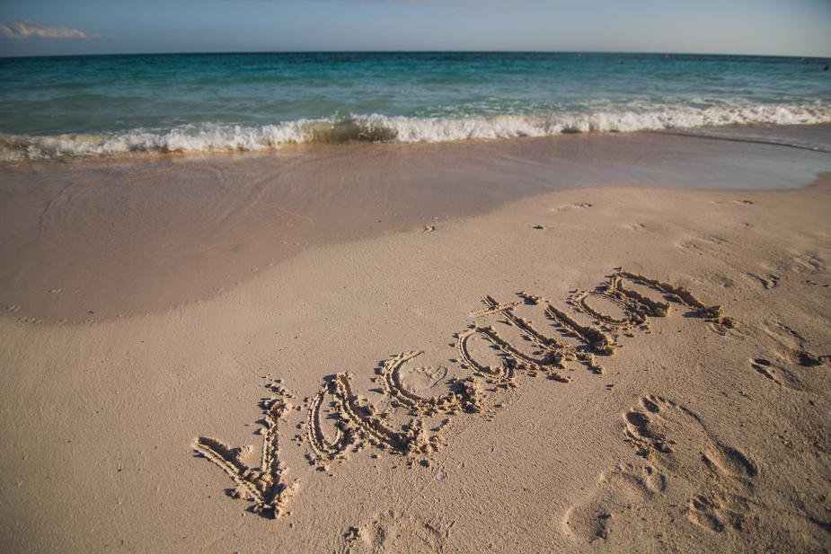 vacation-written-on-beach